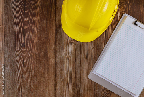 Fotografie, Tablou Engineer working on office desk with blank notebook construction protective yell