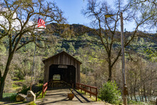 Honeywell Covered Bridge Amidst Trees In Forest Against Sky