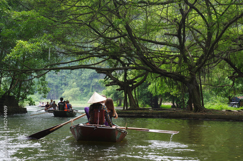 Wallpaper Mural People Sitting On Rowboats In River At Forest