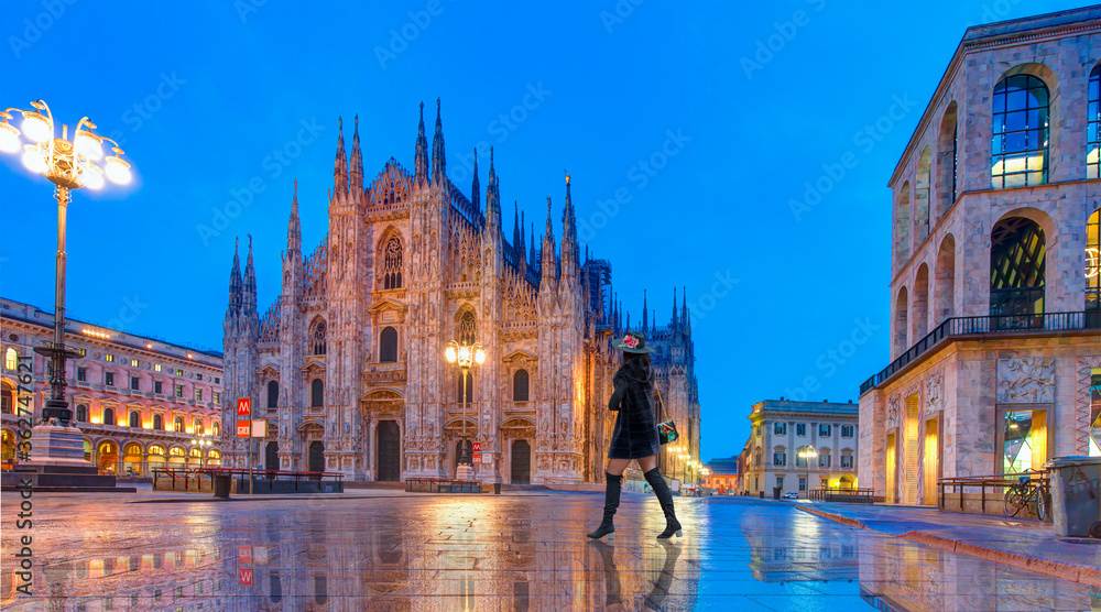 Fototapeta Duomo di Milano (Milan Cathedral) and Piazza del Duomo in the Morning, Milan, Italy - Woman in black clothes walking on the street
