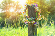 rustic wildflowers wreath. summer flower wreath in garden, sunny day. Farm lifestyle. Summer Solstice Day, Midsummer. floral traditional decor
