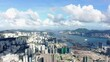 Hong Kong bay and Skyline on a beautiful day, Aerial view.