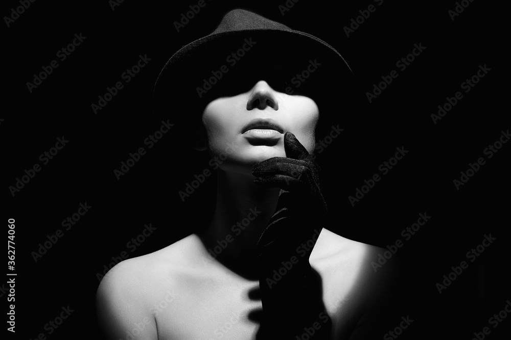Fototapeta Beautiful woman in hat and gloves. Black and white portrait