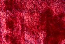 Artificial Red Fur Texture Macro Shot . High Quality Photo