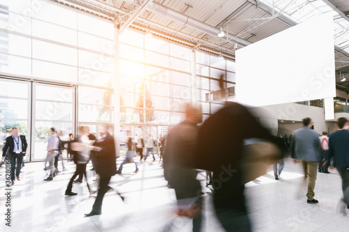 Fototapeta Blurred Motion Of People Walking In Modern Office Building obraz