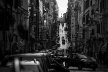 Cars On City Street Amidst Buildings