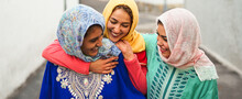 Happy Muslim Women Walking In The City Center - Arabian Young Girls Having Fun Spending Time And Laughing Together Outdoor - Concept Of Lifestyle People Culture And Religion
