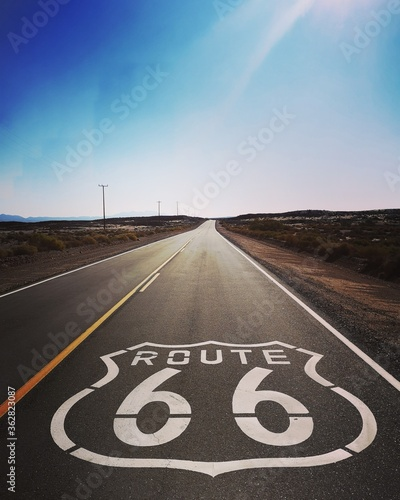 Wallpaper Mural Route 66 Written On Road Against Blue Sky
