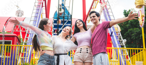 Group of happy best friends laughing and having fun at amusement park, holiday t Fototapet