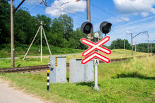 Railroad Crossing With Traffic...