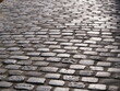 Some cobbles of a small street in the center of Paris. (square dauphine - july 2020)