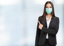 Masked Businesswoman Pointing ...