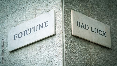 Obraz na plátně Street Sign Fortune versus Bad Luck