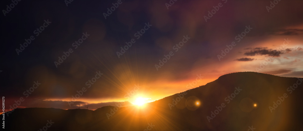 Fototapeta Sunset, sunrise over mountains. Sun and colorful sky background, banner.