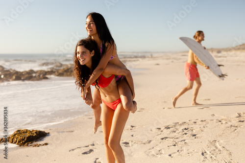 Caucasian women having fun on the beach
