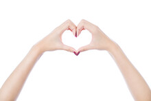 Cropped Hands Of Young Woman Making Heart Shape With Fingers Against White Background
