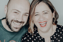 Close-up Portrait Of Cheerful Couple