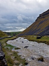 Scenic View Of Swollen Stream Heading Away From Gordale Scar, Yorkshire Dales