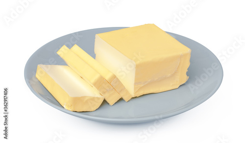 Photo Butter on white plate isolated on white background