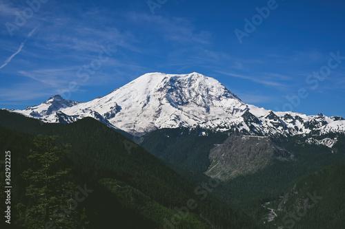 Mount Rainier in daylight with blue sky