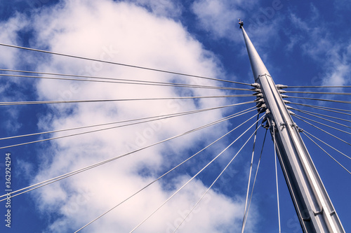 Low Angle View Of Mast Of Sailboat Against Cloudy Sky