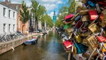 Close-up Of Love Locks On Railing In City