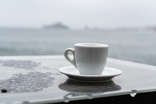 Close-up Of Coffee Cup On Table Against The Sea