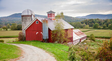 Red Barn With Silo And Corn Fi...