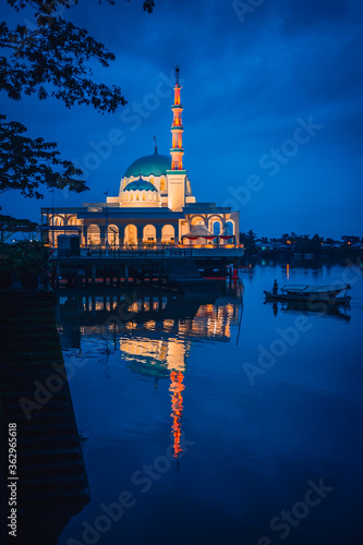 Reflection Of Illuminated Building In Water At Dusk Wallpaper Mural