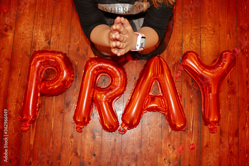 Fotografie, Obraz High Angle View Of Girl Praying With Text On Floor