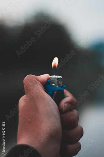 Cropped Hand Of Person Holding Burning Cigarette Lighter Canvas Print