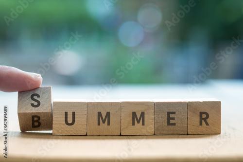 SUMMER BUMMER concept on wood blocks as finger changes S to B Tapéta, Fotótapéta