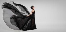 Portrait Of A Mysterious Girl In A Black Flying Dress