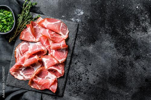Fototapeta Coppa, Capocollo, Capicollo meat popular italian antipasto food.  Black background. Top view. Copy space obraz