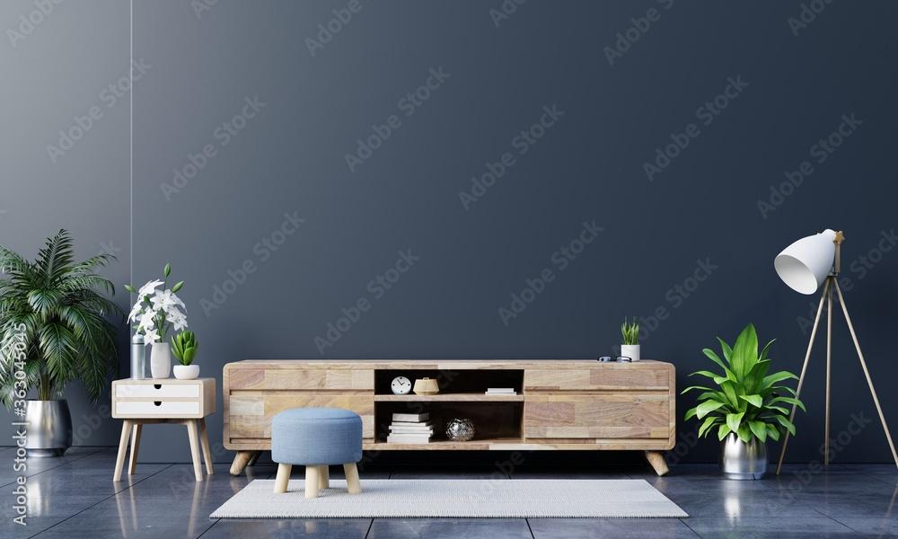 Fototapeta Tv cabinet in modern empty room on dark wall,minimal designs.