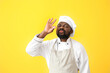 canvas print picture - Male African-American chef on color background