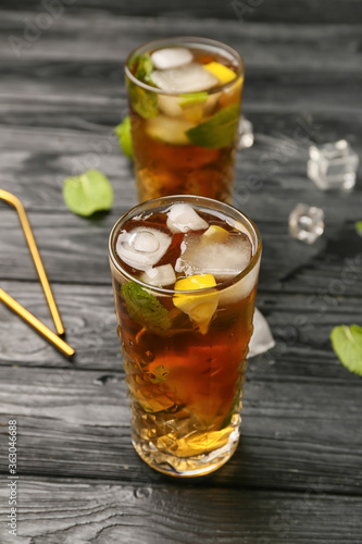 Glasses of tasty Cuba Libre cocktail on table