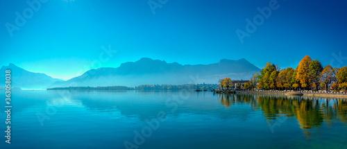 Fotografie, Obraz Scenic View Of Lake Against Blue Sky