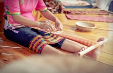 Low Section Of Woman Weaving W...