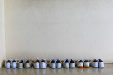 Pair Of Shoes In Row Against Wall
