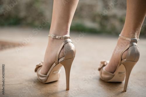 Fotografiet Low Section Of Woman Wearing High Heels