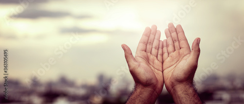 Obraz na plátně Human hands open palm up worship Praying with faith and belief in God of an appeal to the sky