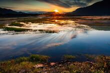 Spectacular Sunrise Over Marshlands With Mountain Range In Background, Wonderful Reflection
