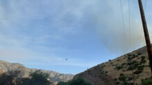 Helicopter Conducting Water Drop At Wildfire