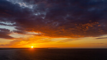 The Sunsets Over The Sea Near Thornwick Bay, Flamborough Head, East Yorkshire, UK
