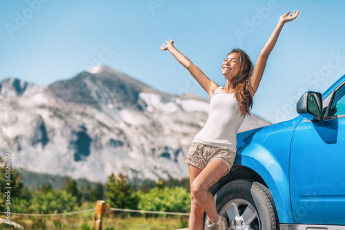 Obraz na plátne Happy road trip tourist girl enjoying driving sport car on summer travel adventure freedom vacation
