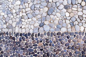 Panel Szklany Podświetlane Abstrakcja Small stone texture decorative on concrete wall gray blue white black background