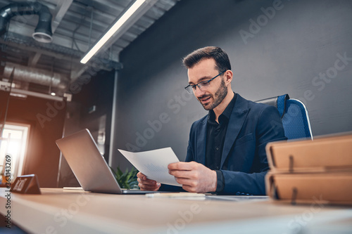 Fototapeta Thoughtful businessman think of online project at the desk obraz