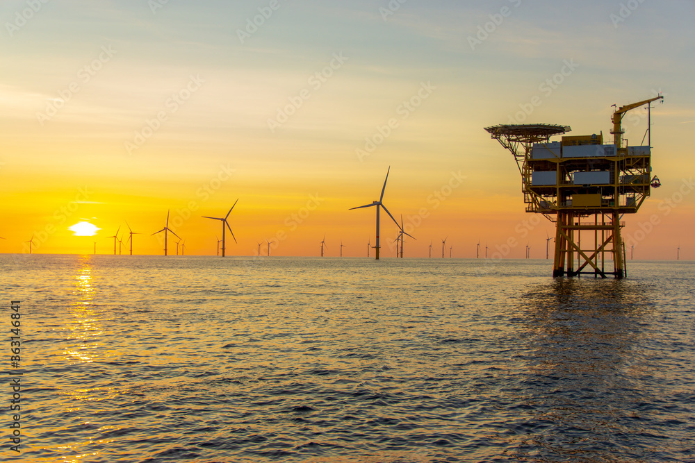Fototapeta Beautiful sunset at the North Sea offshore wind farm