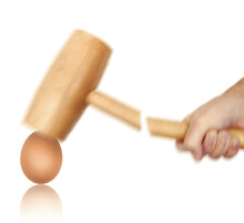 Tough Egg To Crack Concept With Hand Holding Hammer Hitting Egg, Hammer Breaks While Egg Stays Intact, Motion Blur Effect